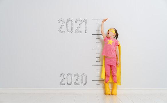 Child in superhero costume between 2020 and 2021