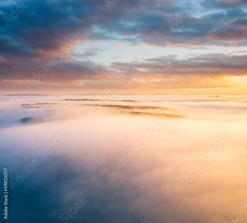 Wall mural Breathtaking top view of the misty valley in the morning. Aerial photography, drone shot.
