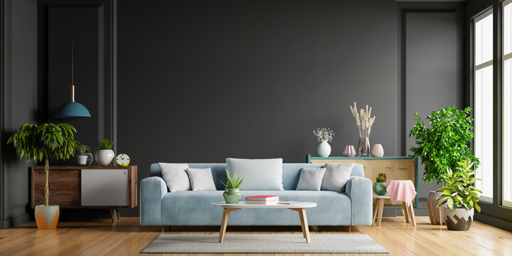 Dark living room,Blue sofa on wooden flooring and black wall.