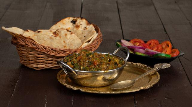 Indian Cuisine Bhindi Masala on Wooden Background