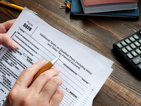 Financial concept meaning Form 5329 Additional Taxes on Qualified Plans (Including IRAs) and Other Tax-Favored Accounts with inscription on the sheet.