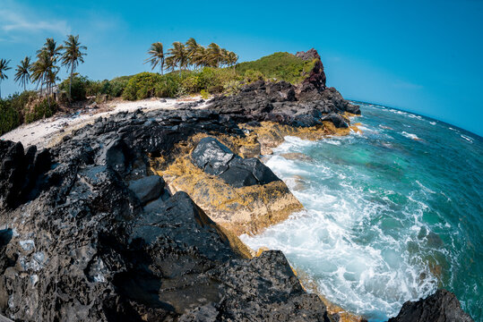 Tropical beach with suny views and waves, rocks and sand background. Travel destinations in Ly Son island, Vietnam  and banner web.