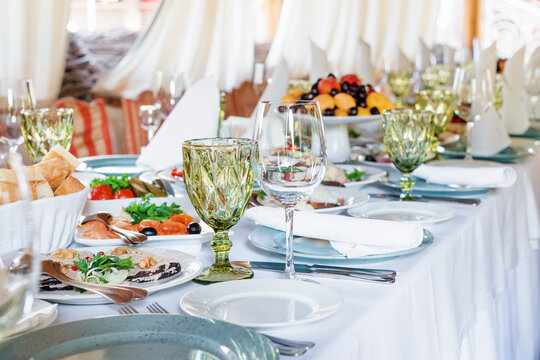 Table decorations for holidays and wedding dinner. Table set for holiday, event, party or wedding reception in outdoor restaurant.