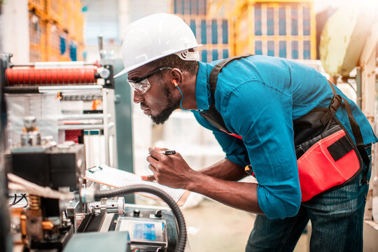 Technician working in factory check functionality while commissioning a production line, Man working