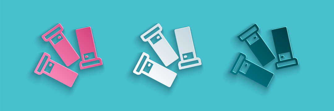 Paper cut Cartridges icon isolated on blue background. Shotgun hunting firearms cartridge. Hunt rifle bullet icon. Paper art style. Vector.