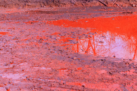 Close-up of red water polluted with iron ore waste