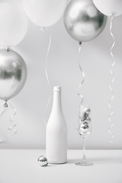 Champagne for celebration with white balloon.