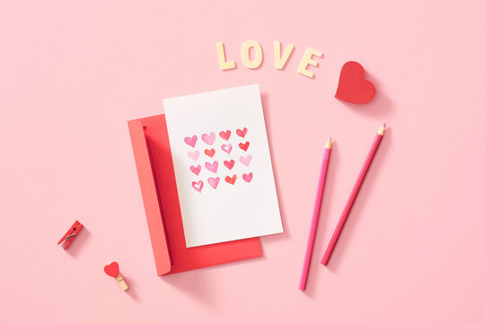 Watercolour heart on a pink background, envelope with a greeting card. Valentine day concept