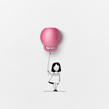 Girl with pink kettle bell balloon.