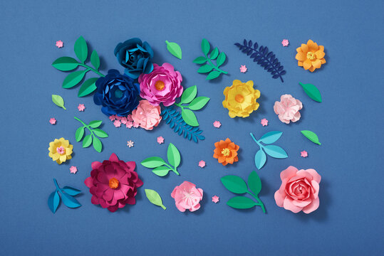 Colorful composition of handmade paper on a blue background