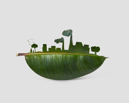 Silhouette of industrial city on a leaf.