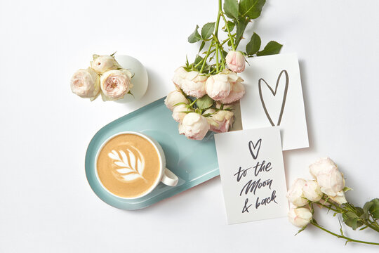 Congratulation card cappuccino cup and roses.
