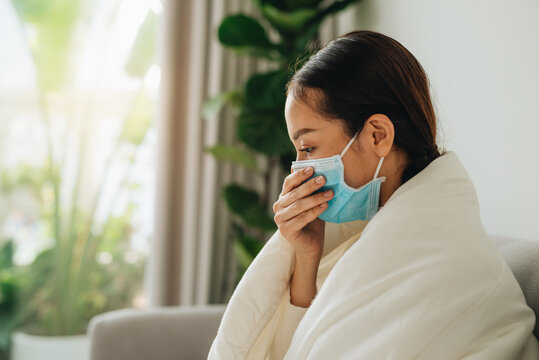Woman with flu, coughing, protective mask