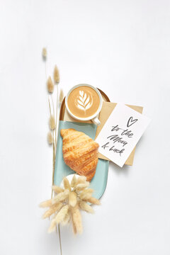 Greeting card with coffee and croissant.