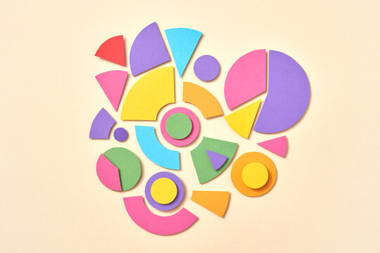 Colorful papercraft geometric figures pattern.
