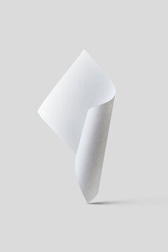 Blank rolled paper vertically floating.