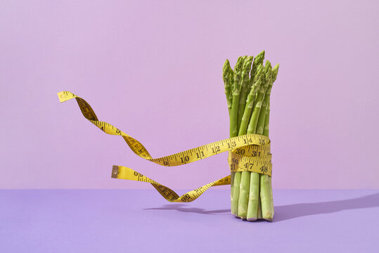 Flying measuring tape around asparagus banch.