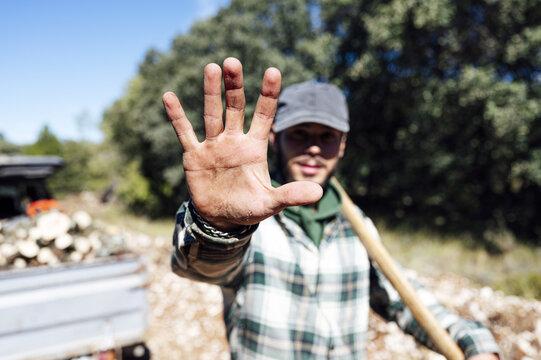 Shot of a man showing  high five