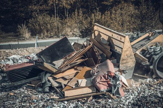 compactor at a landfill processing municipal waste