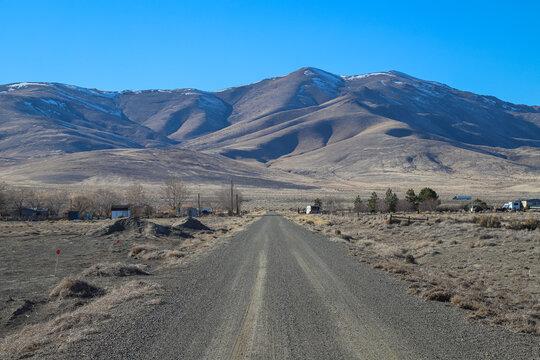 Dirt Roads travel through a rural neighborhood