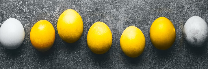 Eggs in line in trendy colors of 2021 yellow and gray, top view, banner, minimal concept. Homemade...