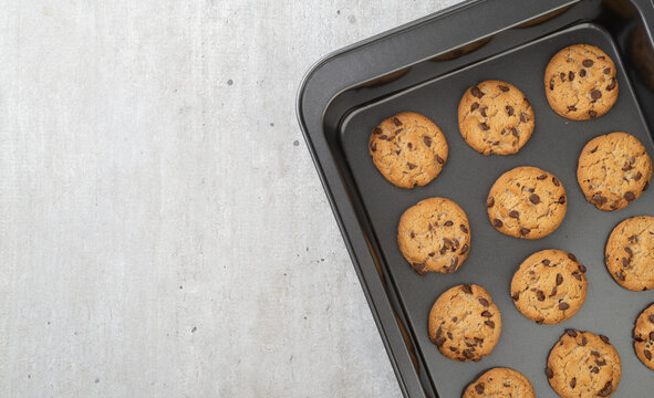 Chocolate chip cookies on a baking tray with copy space