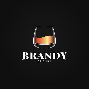 Brandy glass logo. Golden whiskey or cognac