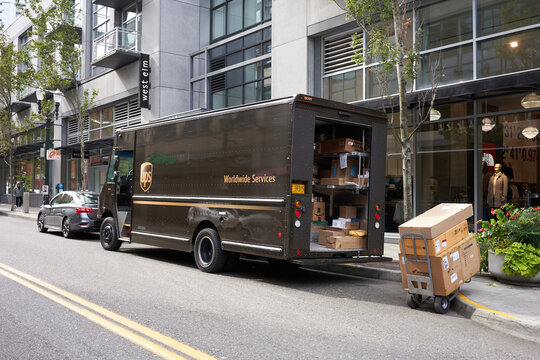 Portland, Oregon, USA - Oct 2, 2019: A UPS delivery truck is seen being unloaded by the roadside in downtown Portland's Pearl District.