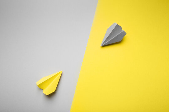 Trend photography on the theme of the new color of the year 2021: Ultimate Gray and Illuminating. yellow and gray planes on the background with copy space