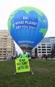 Environmental activists display a hot air balloon in Brussels