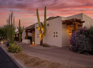 arizona resort with cactus and sunset