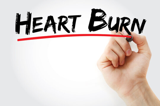Heart Burn text with marker, concept background