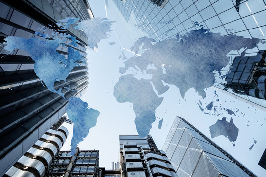 Global Map with a background of corporate skyscraper buildings. Concept piece showing world interconnected with business, finance and trade worldwide