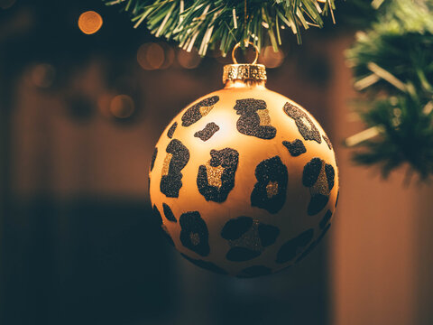 Golden leopard print glass Christmas tree ornament. Holiday decorations.