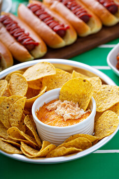Game day food for Super Bowl, chips with buffalo chicken dip and hot dogs