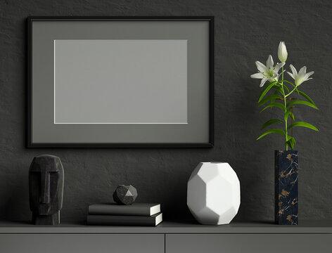 Black mock up poster frame on dark plaster wall with lily flower in marble vase, books, geometric pots, head sculpture; landscape orientation; stylish frame mock up; 3d rendering, 3d illustration