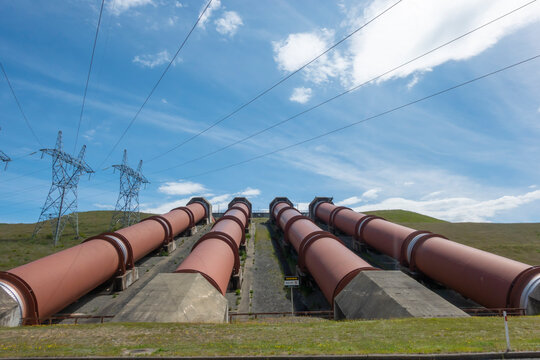 Four large pipes or penstocks sullpying water by gravity to electric power station