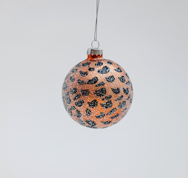 Orange shiny Christmas tree ball with leopard print