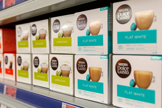Boxes of coffee capsules in the supermarket. Side view. Close-up. Moscow, Russia, 11-25-2020.