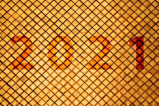 2021 word Abstract - Sculpture of Golden wall  texture square patterns of pagoda at Wat Phra Si Rattana Satsadaram or Royal Grand Palace buddha temple Bangkok Thailand.- New year background