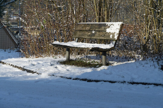 A park bench with a wooden seat