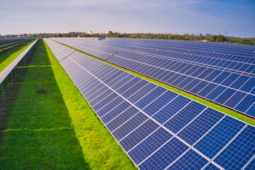 Fototapeta Large solar power plant on a picturesque green field in Ukraine
