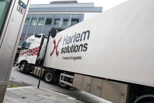 Harlem Solutions truck making a turn.