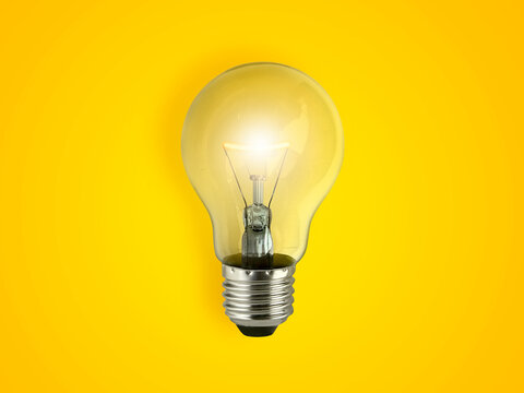 Yellow Light bulb on yellow background. top view. minimal concept.