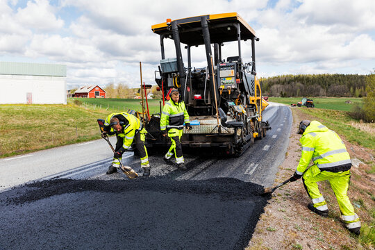 Workers putting new road surface