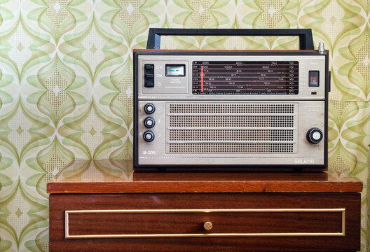 MINSK BELARUS-22.04.2020:Radio Ocean-Selena-B215-B216-B217.Radio (RADIORECEIVER) SELENA B 216 made in the USSR.Antique radio on the nightstand in the room.