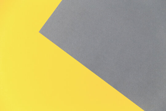Color of the 2021 year 17-5104 Ultimate Gray and 13-0647 Illuminating. Abstract yellow and grey empty geometric background in 2021 color trends.