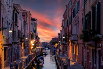 typical Venetian alley called calle at sunset without anyone because of the covid 19