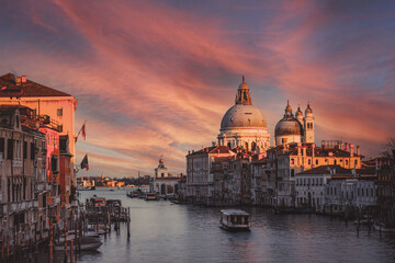 view of the Canal Grand and Basilica of Santa Maria della Salute from the Accademia bridge during covid 19 at sunset