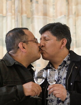 Members of LGBT movement, kiss after a news conference where the first same-sex civil union recognised by the Bolivian Civil Registry in La Paz